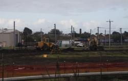 Excavators at work ripping up the track