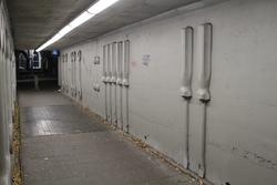 Concrete mural 'Nuts and Bolts' by Geoff Hogg and Enver Cambdel (1995) in the Newport station subway beneath Melbourne Road