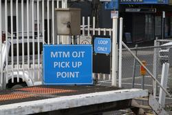 'MTM OJT pick up point' sign at the down end of Newport station