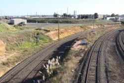 Left to right: pair of low level dual gauge tracks to the grain loop, broad gauge loop line, standard gauge main line