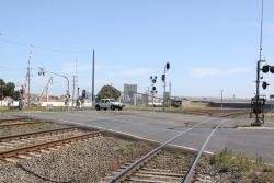 Looking south over the level crossing at Station Street, note the canted tracks and the hump in the roadway