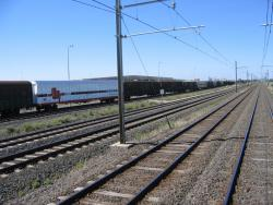 SCT Laverton: SCT freight terminal at Laverton viewed from a passing broad gauge train