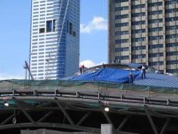 Southern Cross: Workers busy at work cladding the roof