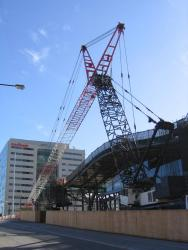 Southern Cross: The huge crane used to remove the three tower cranes from the site