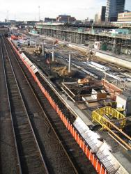 Southern Cross: Work on rebuilding platform 3/4, work on shopping centre and car park in background