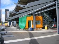 Southern Cross: Awning and suburban ticket office on the Bourke Street bridge underway