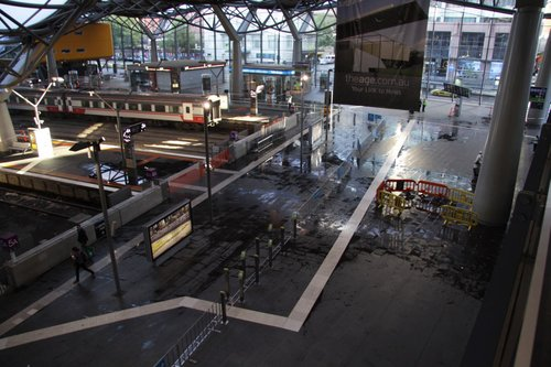 Puddles on the concourse from the storm damage