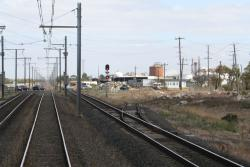 Down the line past the points to nowhere, the signal is for trains approaching Laverton Loop