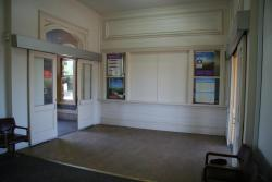 inside the waiting room looking at closed booking office