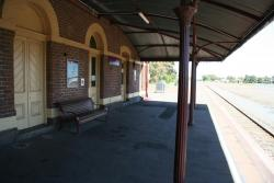 Under the station verandah