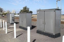 Three equipment cabinets at the Reservoir Road level crossing