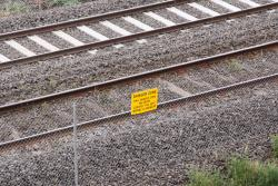 'Danger Zone' sign attached to the fence around the tracks