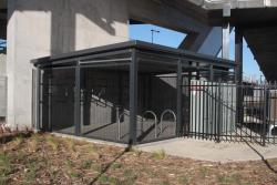 Parkiteer bike cage beneath the Williams Landing entry to the station