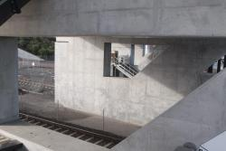 Looking south through the concrete piers that support the station concourse