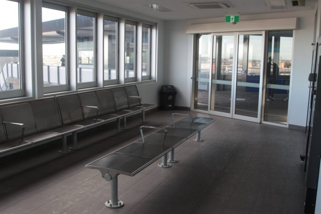 Metal seats in the station waiting room