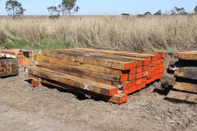 New timber sleepers stabled beside the line