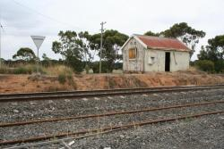 Derelict station building and location signage