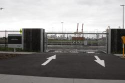 Gates and level crossing accessing the rebuilt Footscray Wharf