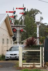 Semaphore signals and a complete signal box in a backyard in Bacchus Marsh