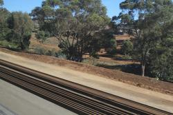 Fresh rails along the alignment of the future second track towards Maddingley
