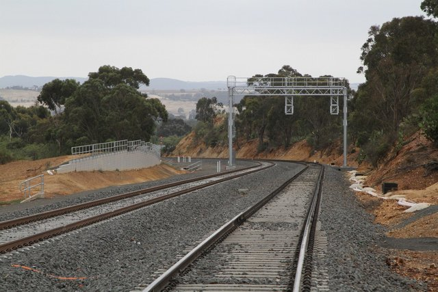 Signal gantry for down trains approaching Maddingley at the Osborne Street level crossing