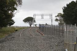 Ballan: Signal gantry for down trains in place at the down end of Geelong-Ballan Road
