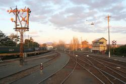 Crossed signals, grain wagons, and signal box