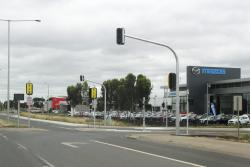 New set of traffic lights installed at the northbound Deer Park Bypass on ramp, permitting pedestrians to access the new station