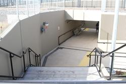 Stairs and ramps link the pedestrian subway to the car park