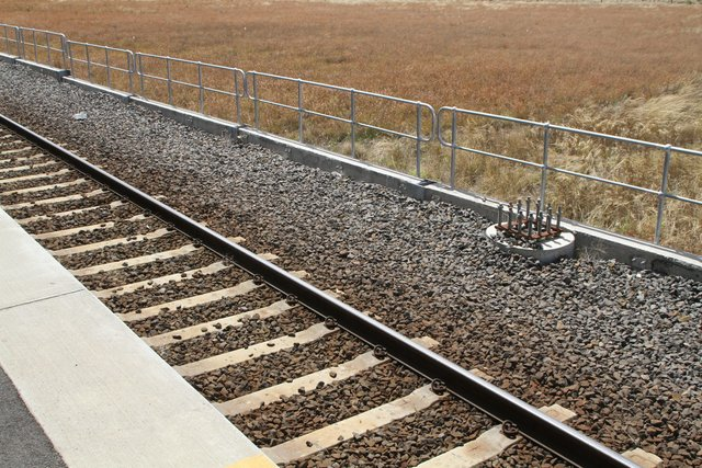 Stanchion bases in place on the north track