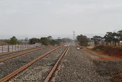 Track duplication heads west from the Ferris Road level crossing towards Melton