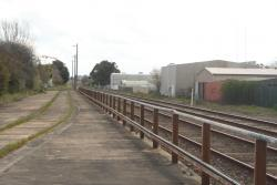 Fence separates the sidings from the main running line