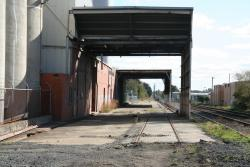 Pair of railway tracks pass through the discharge shed