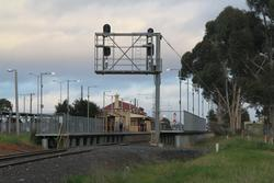 Cantilevered signal gantry at the up end of the station