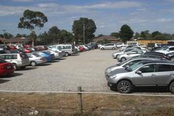 Gravel car park on the south side of Melton station full of cars