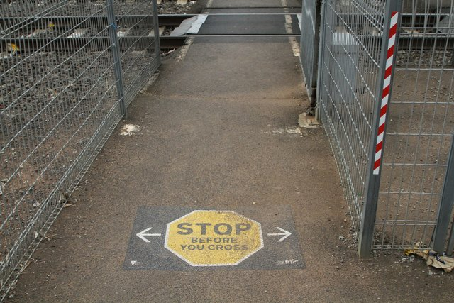 'Stop before you cross' signage at Melton