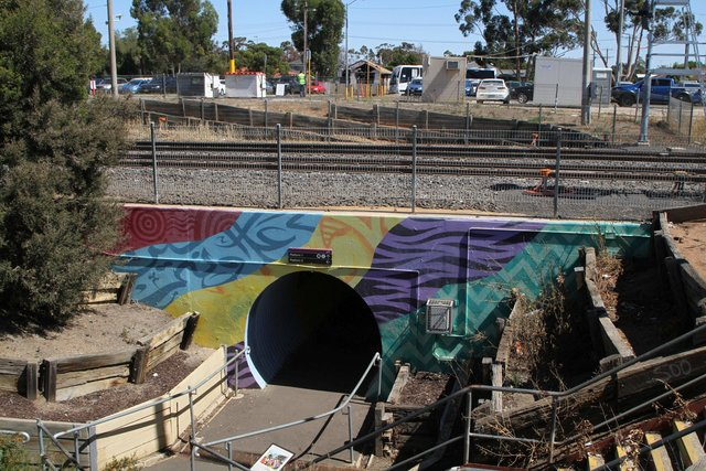 'Beyond Tunnel Vision' mural painted in 2016 on the pedestrian underpass at the down end of the station