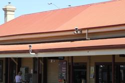 Melton: CCTV cameras on the main station building pointed across the tracks to the entry to the other platform