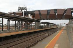 New pedestrian overpass and platform shelters on the north side