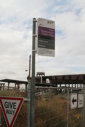 Relocated 'train replacement bus stop' in the gravel car park