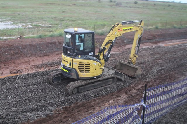 Mini excavator at work tying in the double track at Rockbank