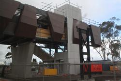 Adding cladding to the new pedestrian overpass