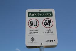 'Park securely' signage in the station car park