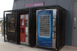 Snack, coffee and cold drink machines caged in for protection from vandals