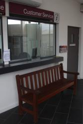 No space in the waiting room, so the second ticket window is blocked by a bench