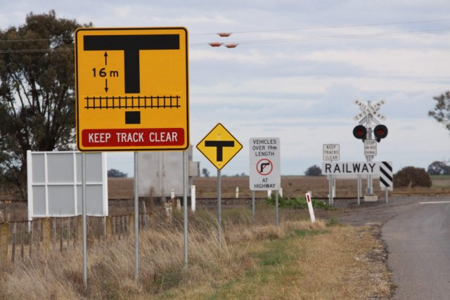 'Keep track clear' and 'No right turn' signs all addressed to trucks