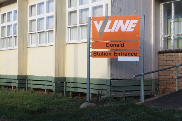Orange V/Line signage outside the station