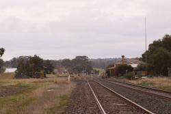 Looking up the disused loop towards number 3 road, the station building, and the goods shed
