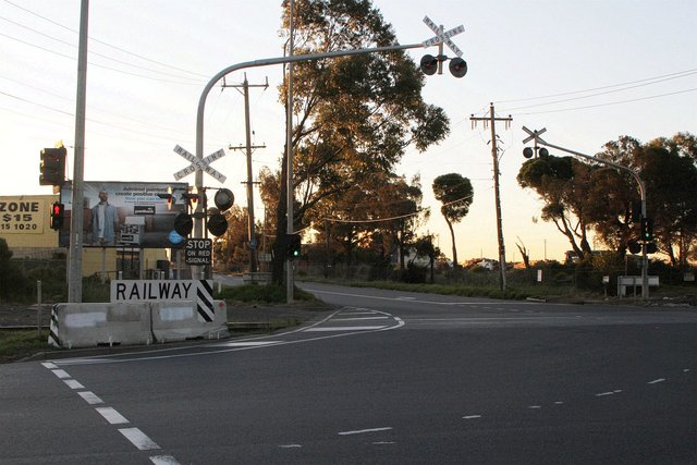 Replacement level crossing light gantry protected by concrete barriers