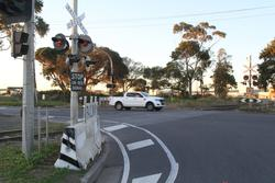 Apex Quarry: Replacement level crossing light gantry protected by concrete barriers